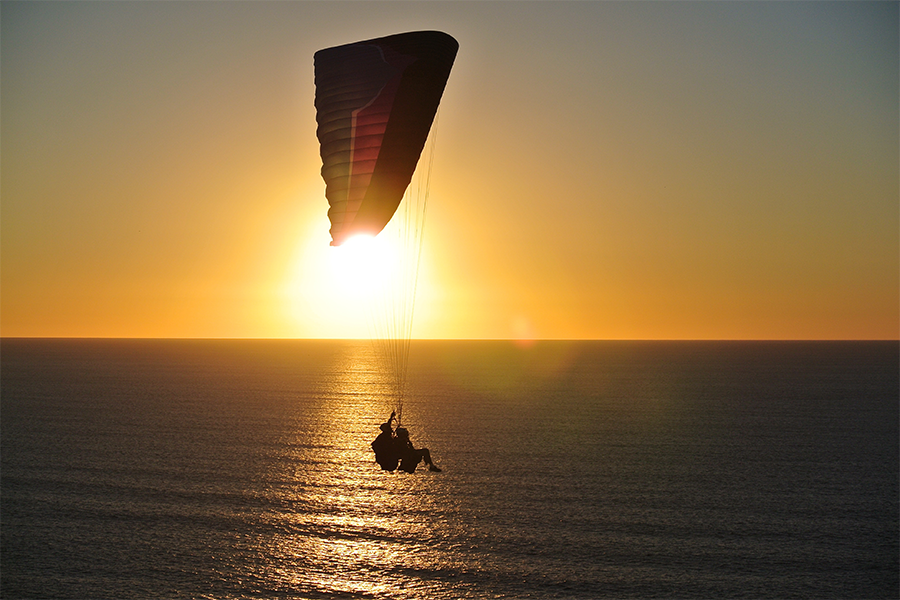 parachuting over the ocean